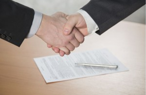 handshake for blog news about merger